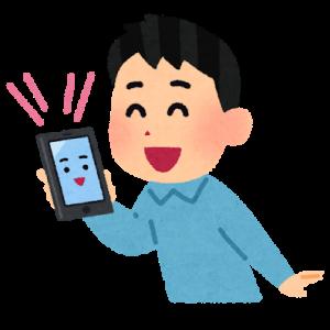 スマートフォンに話しかける男性